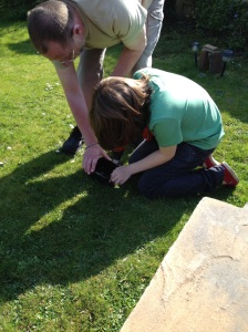 Adding drainage holes to the recycled plant pots